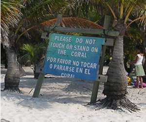 Sign near fragile coral reef